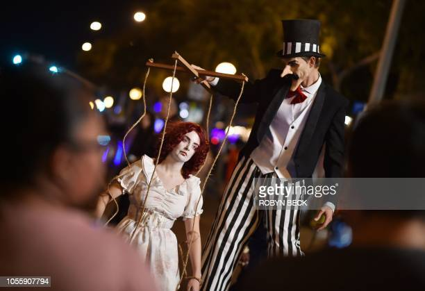Partygoers show off their costumes at the annual West Hollywood Halloween Carnaval billed as the world's largest Halloween party October 31 2018 in...