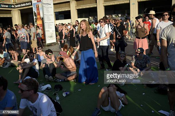 Partygoers take a break during the Sonar Festival 2015 in Barcelona on June 20 2015 The Sonar music festival a rendezvous every year in Barcelona for...