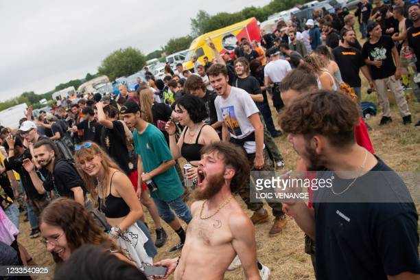 Partygoers take part in an illegal rave party in a field in Redon, north-western France, on June 19, 2021. - Five police officers were injured...