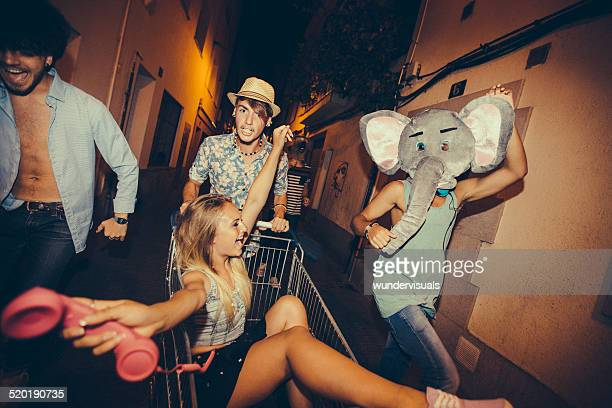 partying teenagers being silly in street - elephant face stock photos and pictures