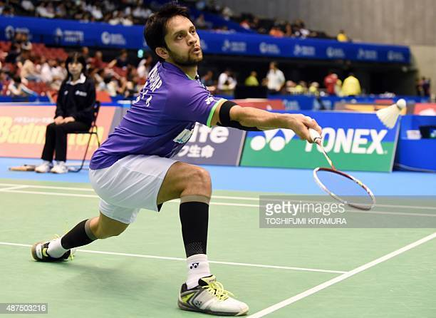 Parupalli Kashyap of India hits a return against K Srikanth of India during their men's singles second round match at the Japan Open Superseries...