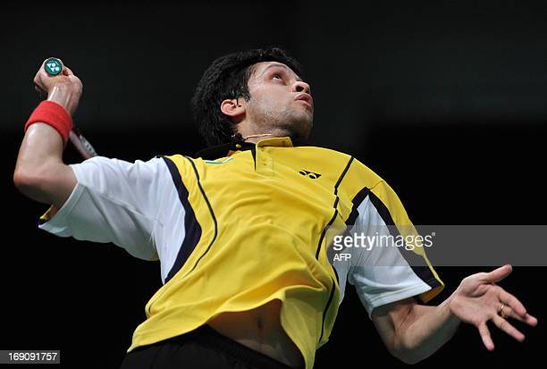 Parupalli Kashyap of India jumps for a smash against Rumbaka Dionysius Hayom of Indonesia during their match at the 2013 Sudirman Cup world mixed...