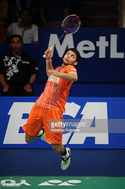 Parupalli Kashyap of India plays a shot against Kento Momota of Japan during the 2015 BCA Indonesia Open Semifinals match at Istora Senayan on June 6...