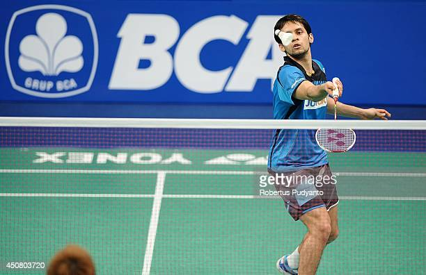 Parupalli Kashyap of India returns a shot against Kenichi Tago of Japan during the BCA Indonesia Open 2014 MetLife BWF World Super Series Premier at...