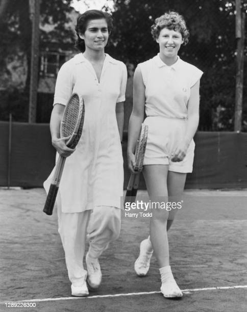 Parveen Sheikh Ahmed of Pakistan and Hazel Moorley of Great Britain walk onto the court for their Women's Singles match at the New Malden Hard Court...