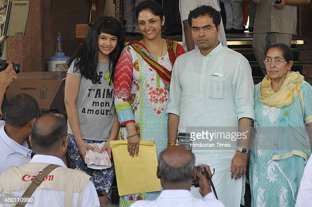 Parvesh Singh Verma with his family members at Parliament House after swearingin for newly elected MPs of Lok Sabha on June 5 2014 in New Delhi India...