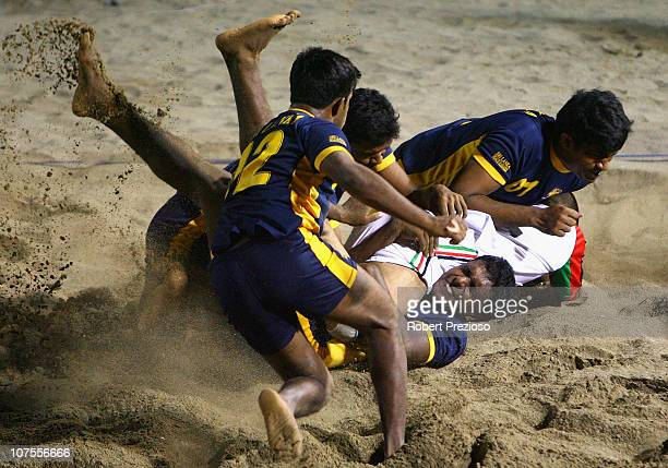 Parwiz Sakhi Zada of Afghanistan competes in the Beach Kabaddi event at North Al Hail during day six of the 2nd Asian Beach Games Muscat 2010 on...