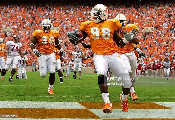 Parys Haralson of the Tennessee Volunteers returns the ball for a touchdown after a fumble by runningback Kenneth Darby of the Alabama Crimson Tide...