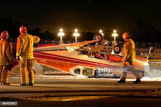 Pasadena, Ca. – Pasadena firefighters work around the wreckage of a Beechcraft V35 Bonanza that crashed late Friday night into the west bound lanes...