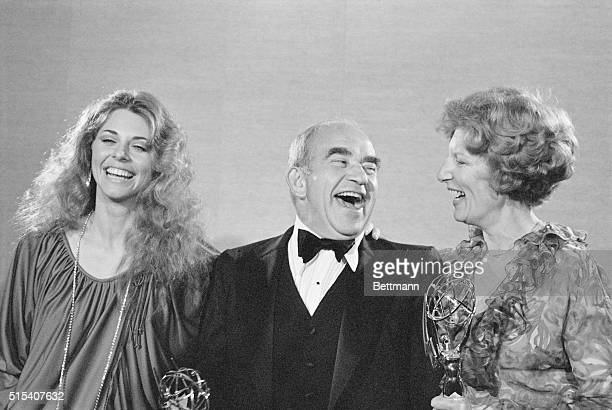 Actress Nancy Marchand and actor Edward Asner seem to be enjoying themselves as they pose for photographers after they were awarded an Emmy as the...