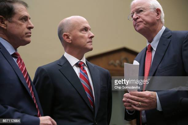 Pasadena City Councilmember Steve Madison former Equifax CEO Richard Smith and Former Republican Senator from Georgia Saxby Chambliss talk before...