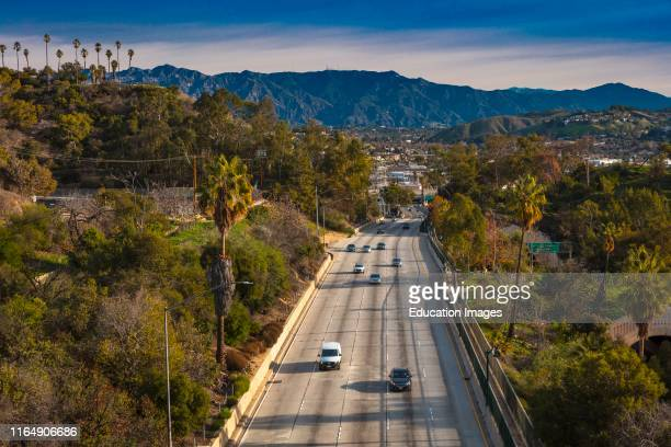Pasadena Freeway, Arroyo Seco Parkway, CA 110 leads to downtown Los Angeles in morning light.