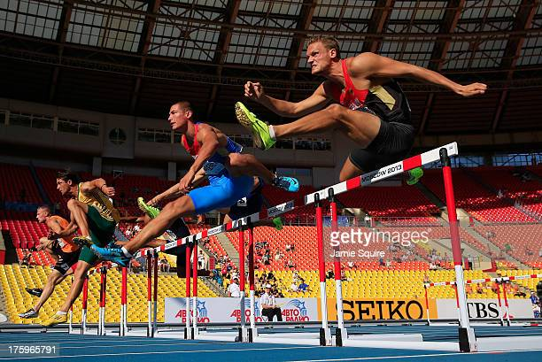 Pascal Behrenbruch of Germany and Ilya Shkurenev of Russia compete in the Men's Decathlon 110 metres hurdles during Day Two of the 14th IAAF World...
