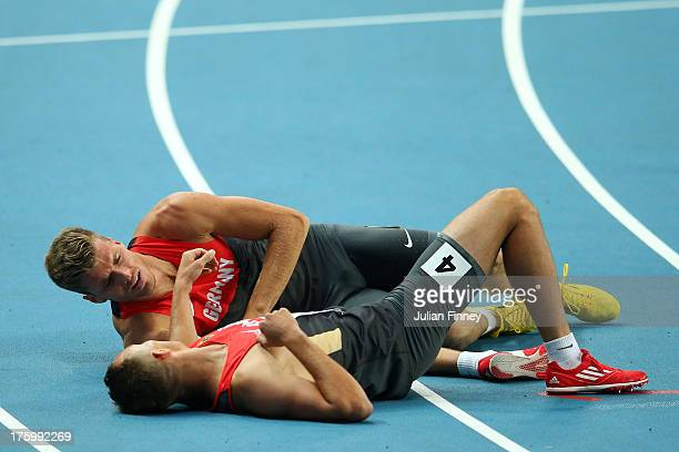 Pascal Behrenbruch of Germany and Michael Schrader of Germany Liechtenstein on the track afte rcompeting in the Men's Decathlon 1500 metres during...