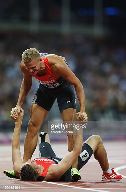 Pascal Behrenbruch of Germany helps Rico Freimuth of Germany to his feet after the Men's Decathlon on Day 13 of the London 2012 Olympic Games at...