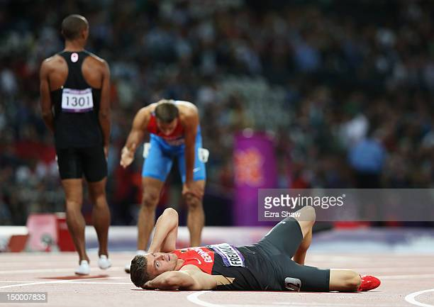 Pascal Behrenbruch of Germany lays on the ground after competing in the Men's Decathlon 400m Heats on Day 12 of the London 2012 Olympic Games at...