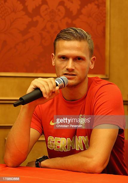 Pascal Behrenbruch of Germany speaks at a press conference ahead of the 14th IAAF World Championships at the Golden Ring Hotel on August 9 2013 in...