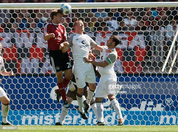 Pascal Bieler of Nuernberg heads his first goal during the second Bundesliga match between 1. FC Nuernberg and FC St. Pauli at the easyCredit stadium...