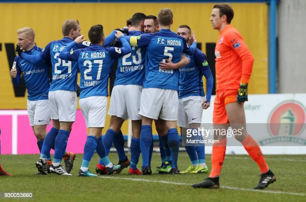 Pascal Breier of Rostock jubilates with team mates after scoring the second goal during the 3Liga match between FC Hansa Rostock and SC Paderborn 07...