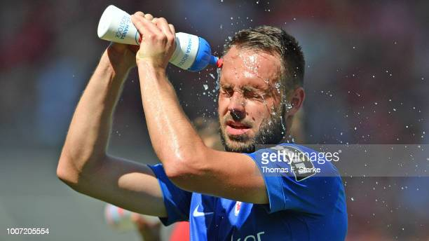Pascal Breier of Rostock refreshes himself during the 3. Liga match between FC Energie Cottbus and F.C. Hansa Rostock at Stadion der Freundschaft on...
