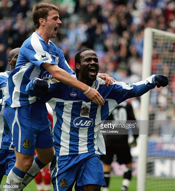 Pascal Chimbonda of Wigan Athletic celebrates his match winning goal with Ryan Taylor during the Barclays Premiership match between Wigan Athletic...