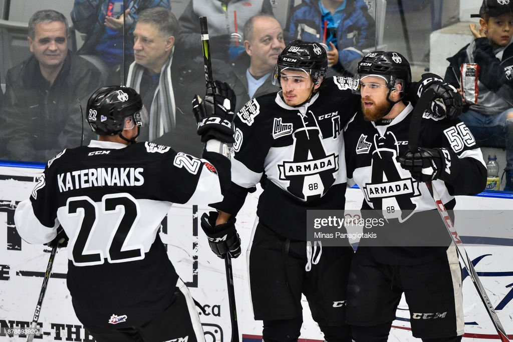 Pascal Corbeil #55 of the Blainville-Boisbriand Armada celebrates his second period goal with teammates Alex Barre-Boulet #19 and Alexander Katerinakis #22 against the Baie-Comeau Drakkar during the QMJHL game at Centre d'Excellence Sports Rousseau on November 24, 2017 in Boisbriand, Quebec, Canada.