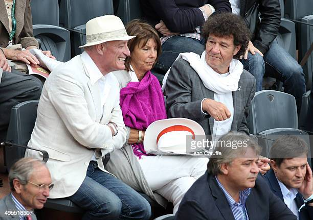 Pascal Desprez husband of Mireille Darc Laurence Charlebois and husband Robert Charlebois attend Day 10 of the French Open 2014 held at RolandGarros...