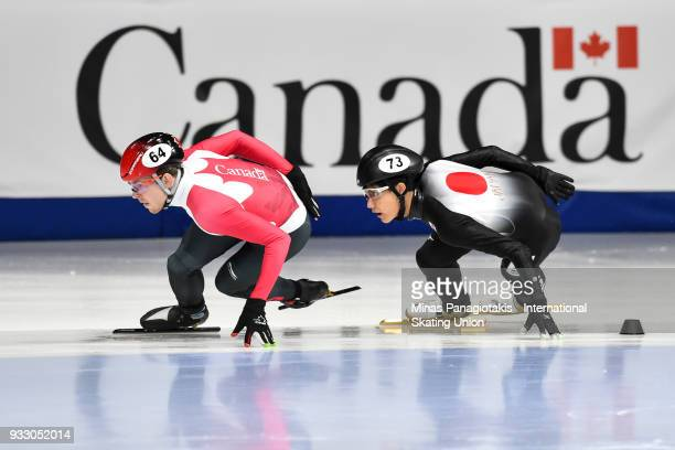 Pascal Dion of Canada competes against Kazuki Yoshinaga of Japan in the men's 1500 meter ranking finals during the World Short Track Speed Skating...