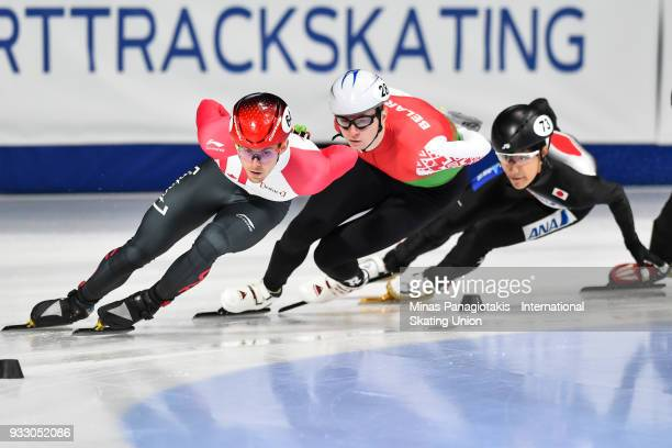 Pascal Dion of Canada competes against Maksim Siarheyu of Belarus and Kazuki Yoshinaga of Japan in the men's 1500 meter ranking finals during the...