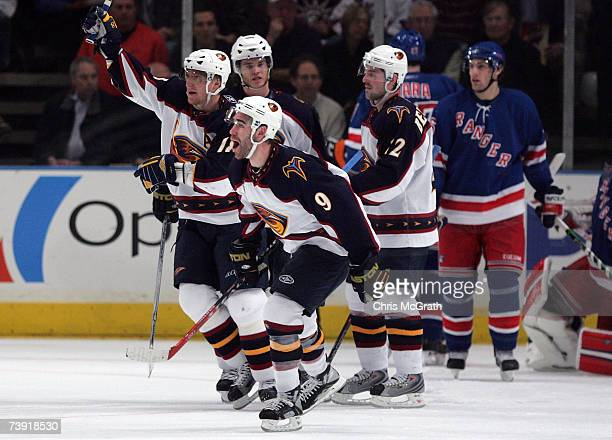 Pascal Dupuis and the Atlanta Thrashers celebrate the goal of Greg de Vries against the New York Rangers iin the second period of game four of the...