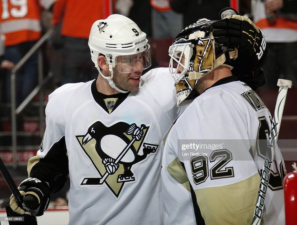Pascal Dupuis #9 and Tomas Vokoun #92 of the Pittsburgh Penguins celebrate after defeating the Philadelphia Flyers 5-4 on March 7, 2013 at the Wells Fargo Center in Philadelphia, Pennsylvania.