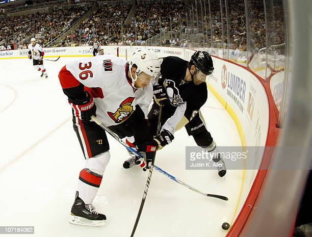 Pascal Dupuis of the Pittsburgh Penguins and David Hale of the Ottawa Senators battle in the corner at Consol Energy Center on November 26 2010 in...