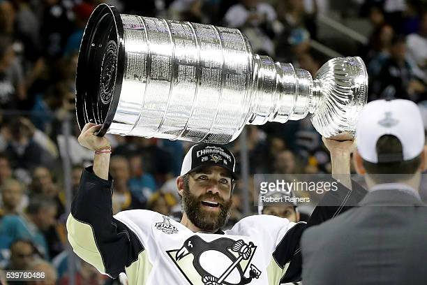 Pascal Dupuis of the Pittsburgh Penguins celebrates with the Stanley Cup after their 31 victory to win the Stanley Cup against the San Jose Sharks in...