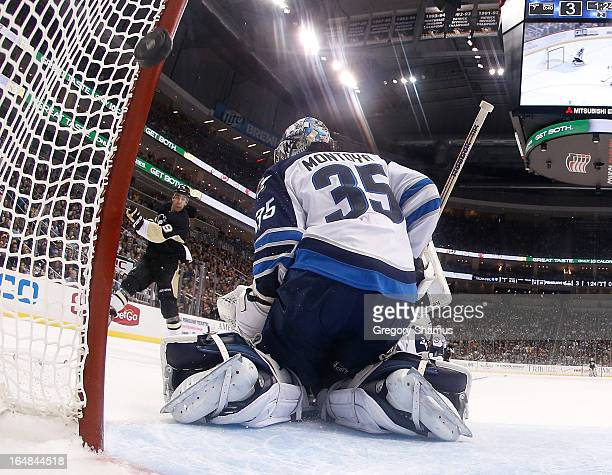 Pascal Dupuis of the Pittsburgh Penguins scores a shorthanded goal on Al Montoya of the Winnipeg Jets on March 28 2013 at Consol Energy Center in...