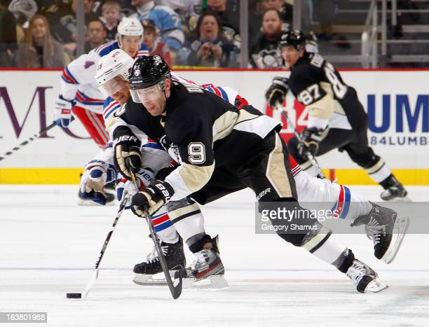 Pascal Dupuis of the Pittsburgh Penguins skates past he defense of Jeff Halpern of the New York Rangers on March 16 2013 at Consol Energy Center in...