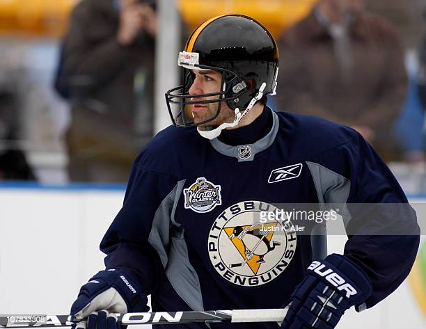 Pascal Dupuis of the Pittsburgh Penguins skates with a Steelers helmet on during the 2011 NHL Winter Classic Practice on December 31 2010 at Heinz...
