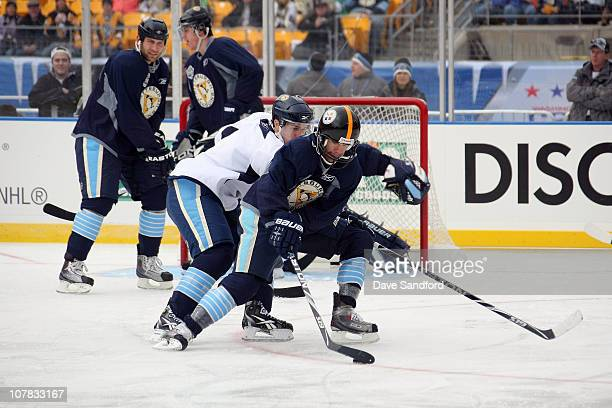 Pascal Dupuis of the Pittsburgh Penguins skates with the puck during practice for the 2011 NHL Bridgestone Winter Classic at Heinz Field on December...