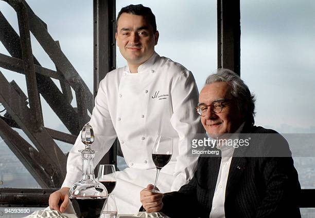 Pascal Feraud head chef left poses with Alain Ducasse chef and restauranter in the Jules Verne restaurant on the 2nd floor of the Eiffel Tower in...