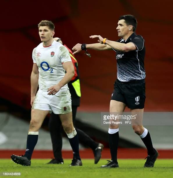 Pascal Gauzere, the referee looks on with England captain Owen Farrell during the Guinness Six Nations match between Wales and England at...