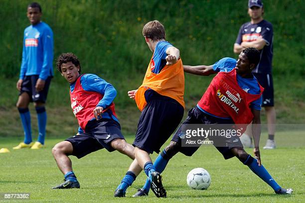 Pascal Gross is challenged by Maicosuel and Carlos Eduardo during a training session of 1899 Hoffenheim during a training camp on July 1, 2009 in...