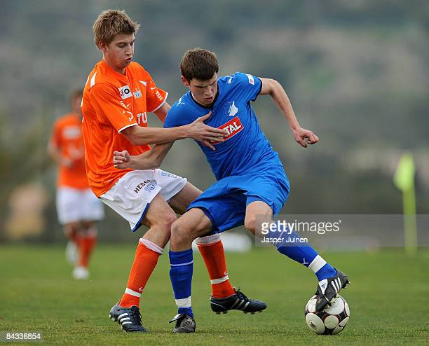 Pascal Gross of 1899 Hoffenheim duels for the ball with Florian Stahel of FC Zuerich during the friendly match between 1899 Hoffenheim and FC Zuerich...