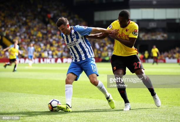 Pascal Gross of Brighton and Hove Albion and Christian Kabasele of Watford battle for possession during the Premier League match between Watford and...