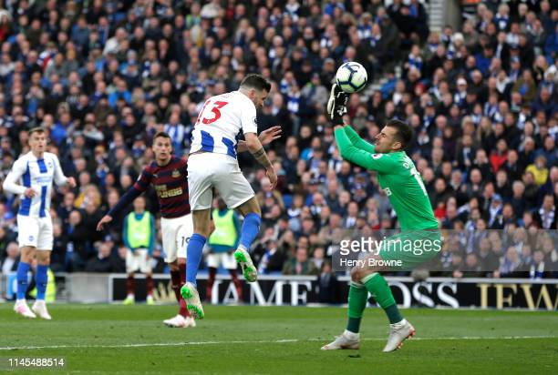 Pascal Gross of Brighton and Hove Albion beats Martin Dubravka of Newcastle United as he scores his team's first goal during the Premier League match...