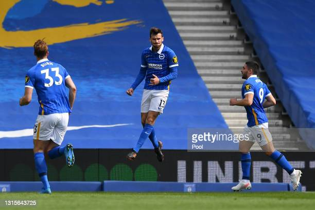 Pascal Gross of Brighton and Hove Albion celebrates after scoring their side's first goal from the penalty spot during the Premier League match...
