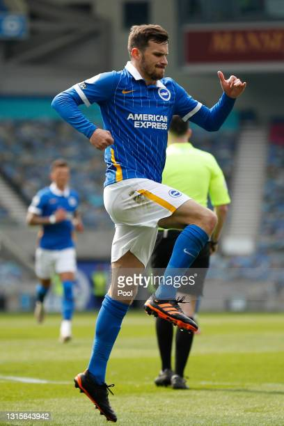 Pascal Gross of Brighton and Hove Albion celebrates after scoring their side's first goal during the Premier League match between Brighton & Hove...