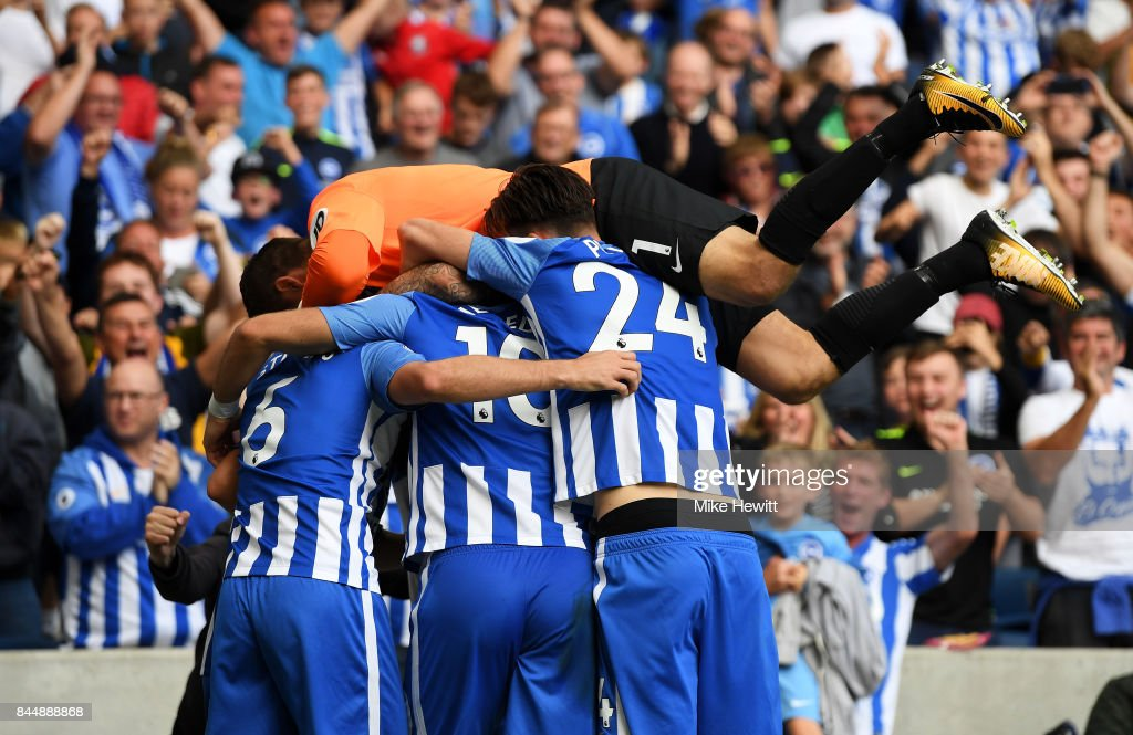 Pascal Gross of Brighton and Hove Albion celebrates scoring his sides second goal with his Brighton and Hove Albion team mates during the Premier League match between Brighton and Hove Albion and West Bromwich Albion at Amex Stadium on September 9, 2017 in Brighton, England.