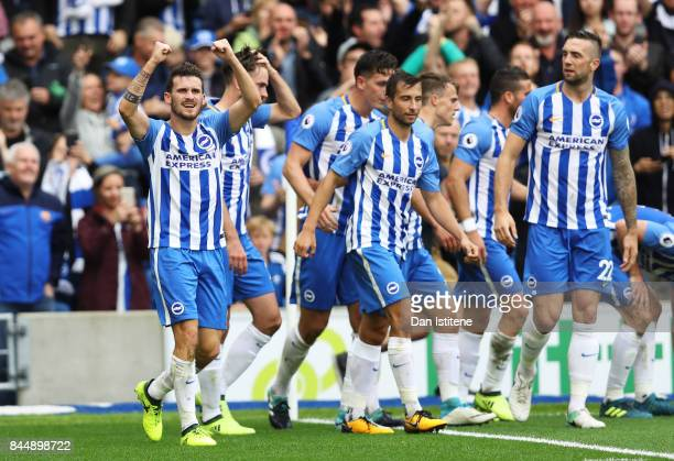Pascal Gross of Brighton and Hove Albion celebrates scoring his sides first goal during the Premier League match between Brighton and Hove Albion and...