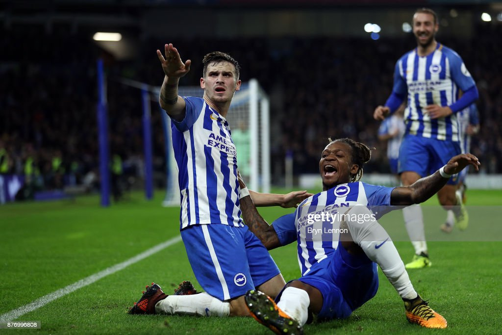 Pascal Gross of Brighton and Hove Albion celebrates scoring his side's first goal with Gaetan Bong during the Premier League match between Brighton and Hove Albion and Stoke City at Amex Stadium onNovember 20, 2017 in Brighton, England.