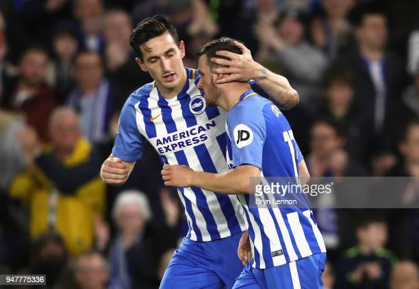 Pascal Gross of Brighton and Hove Albion celebrates with Shane Duffy of Brighton and Hove Albion after scoring his sides first goal from the penalty...
