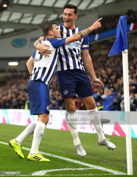 Pascal Gross of Brighton and Hove Albion celebrates with teammate Lewis Dunk after scoring his team's first goal during the Premier League match...